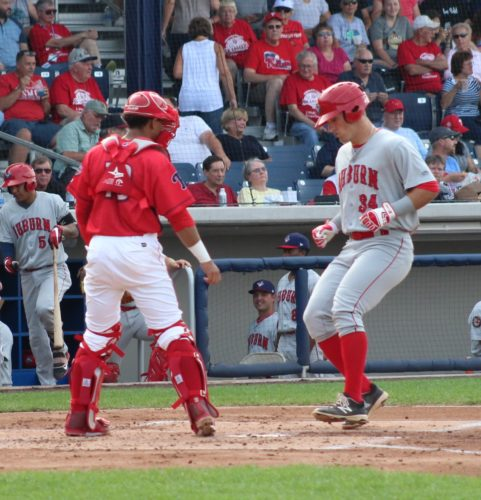 CARA MORNINGSTAR/Sun-Gazette Jake Scudder of the Doubledays scores in front of Cutters catcher Rodolfo Duran Sunday at Bowman Field.