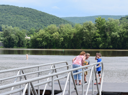 IOANNIS PASHAKIS/Sun-Gazette Although Tina Shay and her son, Cory Shay, right, and grandson Evan Long, left, didn't realize the Hiawatha Paddleboat was closed on Monday, they still enjoyed the scenery along the West Branch of the Susquehanna River at Susquehanna State Park.