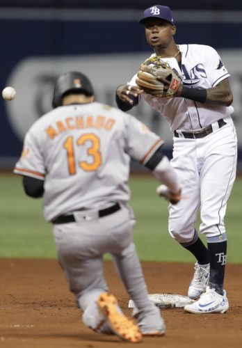 Tampa Bay Rays second baseman Tim Beckham forces the Baltimore Orioles' Manny Machado (13) out at second base and turns a double play on Jonathan Schoop during the sixth inning on Wednesday in St. Petersburg, Fla. (AP)