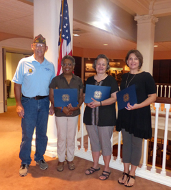 PHOTO PROVIDED Faculty and students in the Mansfield university Department of Education and Special Education recently were honored by the  VFW. From left, are Dan Rieppel, Jannis Floyd, Nanci Werner-Burke and Christina Fry. Missing from the photo is Rebecca Parks.