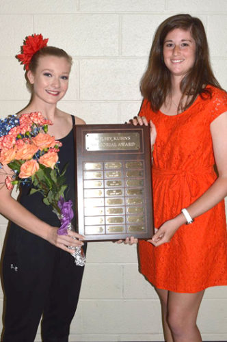 PHOTO PROVIDED Morgan Stone, left, receives the Kelsey Kuhns Memorial Award from Kylie Kuhns, founder of Kelsey's Dream.
