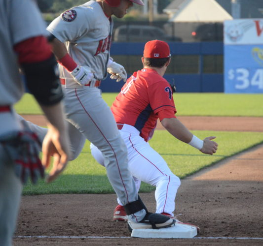 Williamsport Crosscutters' first baseman Greg Pickett (8) catches a throw at first base to retire Auburn Doubledays' Jake Scudder (22) in the first inning on Saturday evening at BowmanField.The Cutters won, 3-1. (KATELYN HIBBARD/Sun-Gazette)