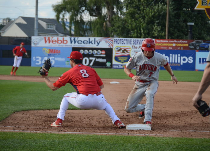 The Auburn Doubledays' Jonathan Pryor races back to first base before first baseman Greg Pickett fields the throw during Sunday's game at Bowman Field. (KATELYN HIBBARD/Sun-Gazette)