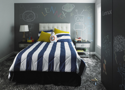 This undated photo provided by Formica Corporation shows a child's bedroom which includes the new Formica Writable Surfaces in the Black ChalkAble design and the Gray ChalkAble design. (Courtesy of Formica Corporation via AP)
