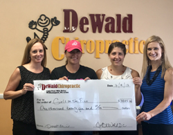 PHOTO PROVIDED From left, are Dr. Jenifer DeWald, DeWald Chiropractic; Shannon Butters, executive director of Girls on the Run; Dr. Shauna Deschenes, DeWald Chiropractic; and Kristen Callahan, DeWald Chiropractic practice representative.