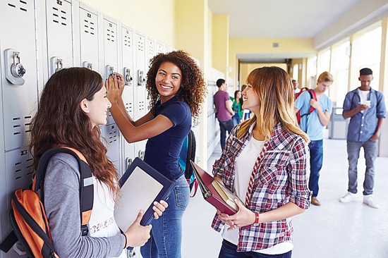 FAMILY FEATURES Students stand at their lockers in this photo courtesy of Getty Images. School days are right around the corner, so take some time to get organized.