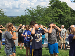 PHOTO PROVIDED Jersey Shore Area School District recently hosted at STEM camp. At top, students use NASA solar glasses donated by NASA Goddard. The students learned how to safely observe the sun and the solar eclipse on Aug. 21.