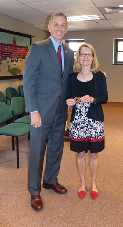 PHOTO PROVIDED Fran Hendricks, Mansfield University president, is shown with Kathy Wright, MU Presidential Coin for Excellence recipient.