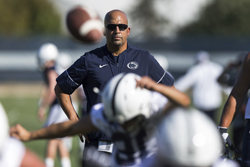 Penn State head coach James Franklin directs his team during NCAA college football practice on the outdoor fields at Lasch in State College, Pa., Monday, July 31, 2017. (Joe Hermitt/PennLive.com via AP)