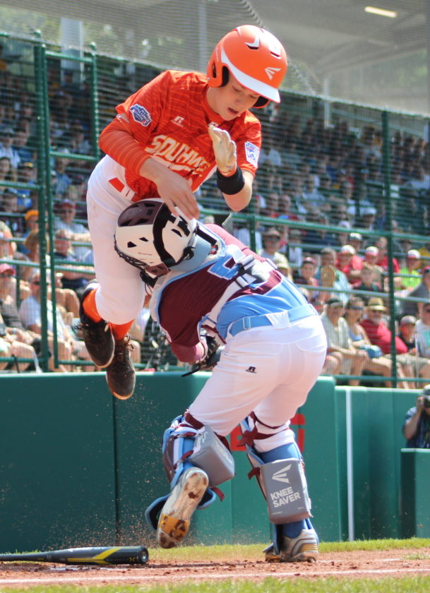 Chandler Spencer, of Texas, tries to run home as Connecticut's Aidan Rivera plays catcher during Sunday's game at Lamade Stadium in South Williamsport. (CARA MORNINGSTAR/Sun-Gazette) Chandler Spencer, 19 of Southwest, tries to run home as Aidan Rivera, 5 of New England, plays catcher during the Southwest versus New England Little League game at Lamade Stadium at the Little League World Series Complex in South Williamsport on Sunday.