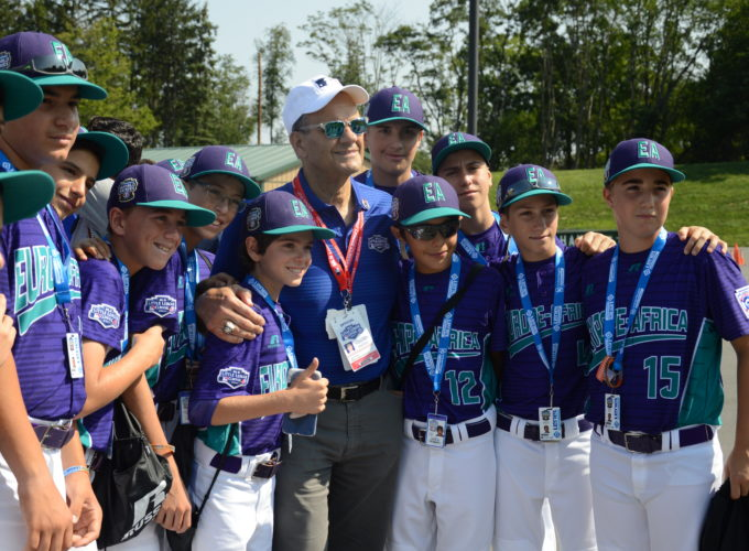 Joe Torre poses for photographs with members of the Emilia, Italy team, representing the Europe-Africa region, on Sunday at the Little League World Series complex. (KATELYN HIBBARD/Sun-Gazette)