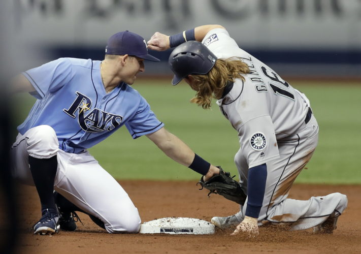 Tampa Bay Rays second baseman Brad Miller, left, tags out Seattle Mariners' Ben Gamel attempting to steal second base during the third inning of a baseball game, Sunday, Aug. 20, 2017, in St. Petersburg, Fla. (AP Photo/Chris O'Meara)