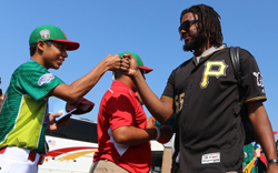 Pittsburgh Pirate Josh Bell  is greeted by a Little League player from Reynosa, Tamaulipas Mexico at the Williamsport Regional Airport on Sunday. KAREN VIBERT-KENNEDY/Sun-Gazette