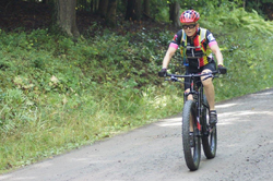 PHOTO COURTESY OF  JENNIFER SHERWOOD  Charmian Breon,  of South Williamsport, heads for the  finish line in Asaph to be the first-place female finisher in the Expert category during last September's Laurel Classic Mountain Bike Challenge.