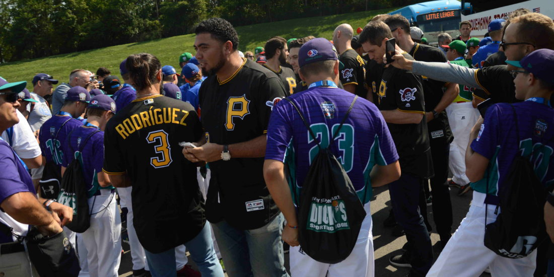 Members of the Pittsburgh Pirates interact with various teams from the Little League World Series in South Williamsport on Sunday. (KATELYN HIBBARD/Sun-Gazette)