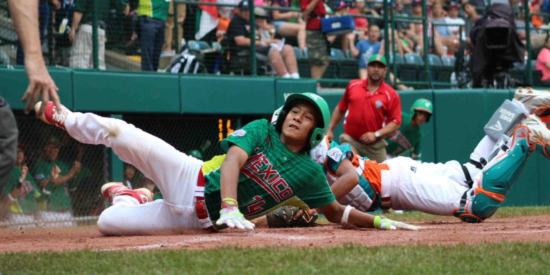 CARA MORNINGSTAR/Sun-Gazette Mexico's Cesar Monjaraz slides home during Mexico's game against Venezuela  at Lamade Stadium in South Williamsport on Tuesday. Mexico won and eliminated Venezuela while advancing to face whoever loses today's Japan and Canada game. (CARA MORNINGSTAR/Sun-Gazette) Cesar Monjaraz, 14 of Mexico, slides home during the Mexico versus Latin America Little League baseball game at Lamade Stadium at the Little League World Series Complex in South Williamsport on Tuesday.