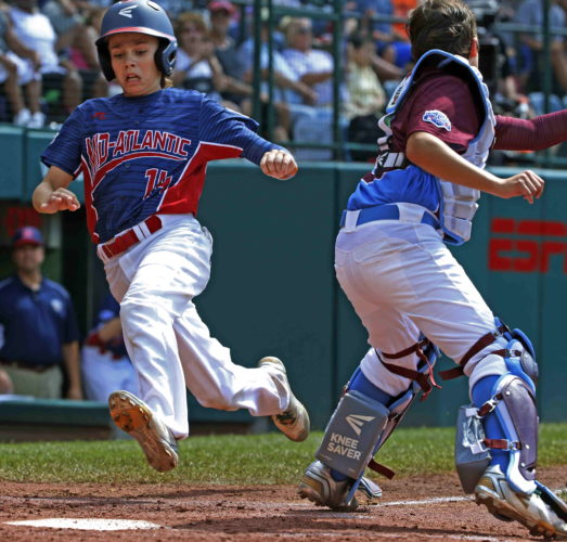 NewJersey's Charlie Meglio beats the attempted tag by Connecticut catcher Aidan Rivera to score on a single by Dean Daddio in the second inning of an elimination game in South Williamsport on Wednesday. (AP)