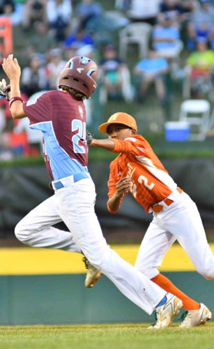 Texas second baseman Malcolm Deason tags out Connecticut's Michael Iannazzo in the first inning on Thursday at Lamade Stadium in an elimination game.  (MARK NANCE/Sun-Gazette)