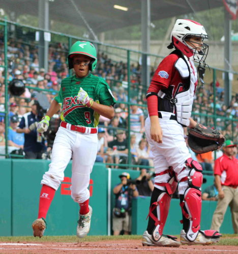 Mexico's Isaac Miranda runs home as Canada's Matteo Manzi plays catcher during the Mexico and Canada elimination game at Lamade Stadium in South Williamsport on Thursday. Mexico advanced to face Japan on Saturday in the International Championship, eliminating Canada from the tournament. (CARA MORNINGSTAR/Sun-Gazette) Isaac Miranda, 9 of Mexico, runs home as Matteo Manzi, 10 of Canada, plays catcher during the Mexico versus Canada Little League baseball game at Lamade Stadium at the Little League World Series Complex in South Williamsport on Thursday.