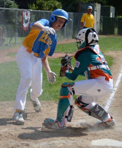 Bobby Gray of Rancho Santa Margarita, Calif., tries to evade Maracaibo, Venezuela, catcher Luis Rodriguez at Original. (KATELYN HIBBARD/Sun-Gazette)