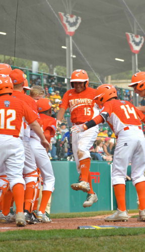 Mark Requena of Texas stomps on home plate as he is congratulated by teammates after hitting a two-run home run, putting Texas ahead in the top of the sixth inning, en route to a win over NorthCarolina in the United States Championship. (MARK NANCE/Sun-Gazette)