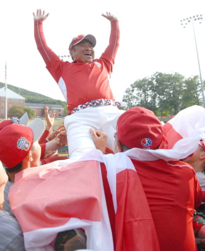 Members of Japan's team lift up their coach to celebrate after Japan defeated Lufkin, Texas in the Little League World Series Championship on Sunday afternoon at Lamade Stadium. (MARK NANCE/Sun-Gazette)