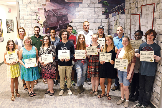 PHOTO PROVIDED 2017-18 Uptown Music Collective scholarship recipients are shown with scholarship donors and stewards at the awarding ceremony on Aug. 15.