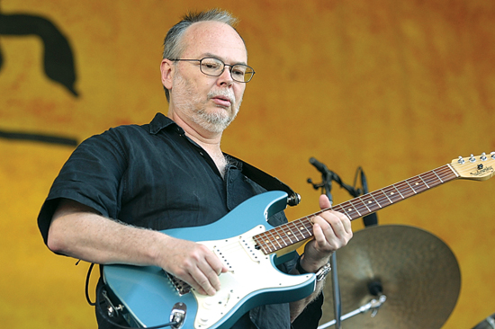 FILE - In this Sunday, May 6, 2007, file photo, Walter Becker, of Steely Dan, performs during the 2007 Jazz and Heritage Festival in New Orleans. Becker, the guitarist, bassist and co-founder of the rock group Steely Dan, has died. He was 67. His official website announced his death Sunday, Sept. 3, 2017, with no further details. (AP Photo/Dave Martin, File)
