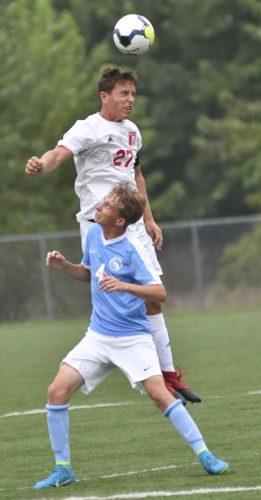 MARK NANCE/Sun-Gazette Williamsport's Cam Pardoe (27) heads the ball over Central Mountain's Matthew Storeman (4) in the first half Tuesday at Williamsport.