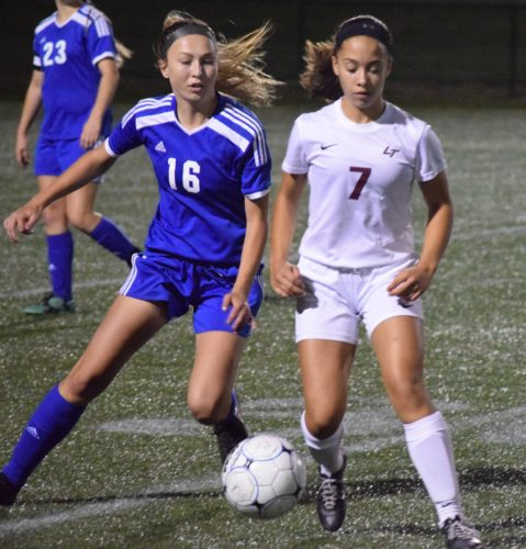 IOANNIS PASHAKIS/ Sun-Gazette Juliana Cruz of Loyalsock, right, and Lexie Yerger of South Williamsport, left, fight for the ball in the second half Tuesday at Loyalsock.