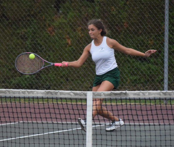 Hughesville's Riley Emerick returns a serve at No. 2 doubles against Montoursville's Alena Clary and Tori Kleese on Wednesday at Montoursville. Emerick's partner was Emily Watts (not pictured). (IOANNIS PASHAKIS/ Sun-Gazette)