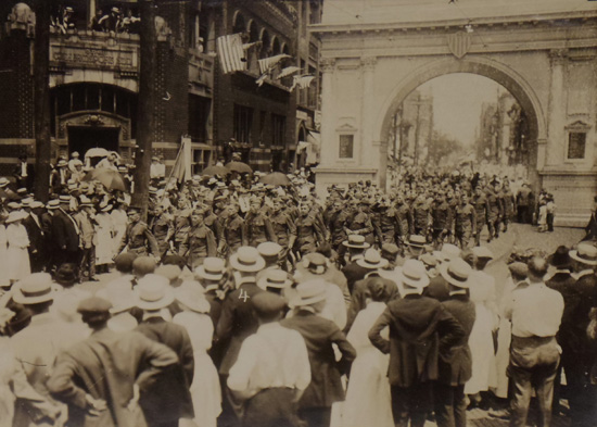 "PHOTO PROVIDED Returning home from the war in June 1919, local National Guardsmen marched under a ""victory arch"" erected near the corner of West Fourth and Hepburn streets, as shown in this photo courtesy of the Lycoming County Historical Society."