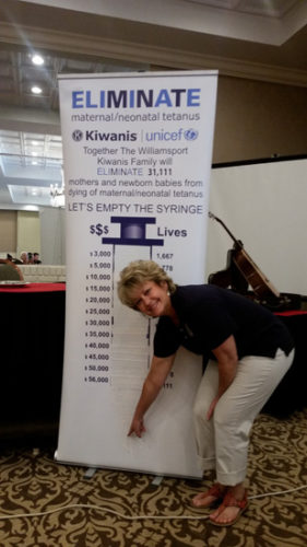 PHOTO PROVIDED Dawn Astin, Kiwanis Club president, shows the ELIMINATE syringe is now full.