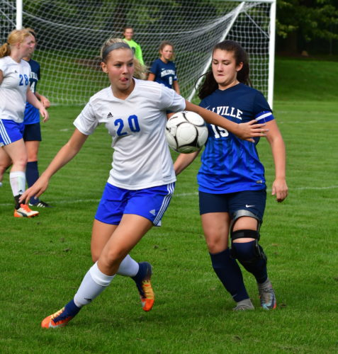 South Williamsport's Bella Green (20) and Millville's Alissa Frey (19) battle for control of the ball during the first half on Thursday at South Williamsport. (MARK NANCE/Sun-Gazette)