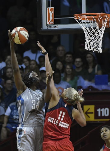 Minnesota Lynx center Sylvia Fowles (34) scores a layup despite the defense by Washington Mystics guard Elena Delle Donne (11) during the first half of Game 2 of the WNBA basketball semifinals, Thursday, Sept. 14, 2017 in Minneapolis. (Aaron Lavinsky/Star Tribune via AP)