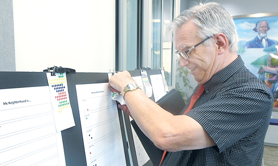 MARK MARONEY/Sun-Gazette Dallas Miller places a pin Monday afternoon on a board to provide demographic data points prior to a focus group discussion on opportunities and economic growth in Williamsport. The event was part of the Heart of Williamsport program.