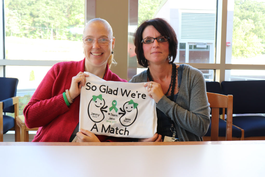 PHOTO PROVIDED Kidney recipient Jenn Pick, left, and kidney donor Jenn Gray hold a T-shirt made for each of them to wear.