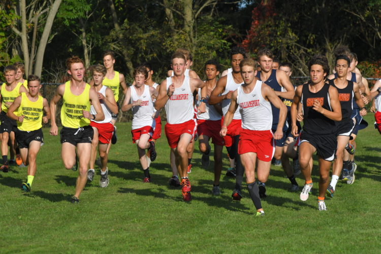 Williamsport's Tyler Holcomb, second right, and Jersey Shore's Isaac Davis, right, make their way to the front of the pack at the start of the race during a quad meet between Williamsport, Jersey Shore, Montoursville, and Southern Columbia at Williamsport. (MARK NANCE/Sun-Gazette)