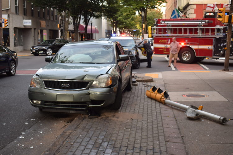 IOANNIS PASHAKIS/Sun-Gazette According to police, an unknown vehicle rear-ended a Ford sedan on the intersection of Fourth and Williams streets and drove away after the sedan struck a traffic light and a street light with the force of the blow.