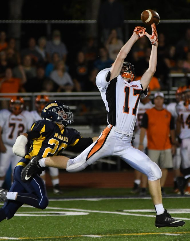 MARK NANCE/Sun-Gazette Jersey Shore's Hunter Frantz (17) goes high for a pass but come up empty handed as Montoursville's Dylan Moll (20) defends in the second quarter.