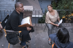 "ASSOCIATED PRESS In this photo, director Lee Daniels, left, talks with cast members Queen Latifah, and Ryan Destiny, foreground right, on the set of the Fox musical drama ""Star"" in Atlanta. Both ""Star"" and Daniels' other series, ""Empire,"" premieres Wednesday, starting at 9 p.m. Eastern on Fox."