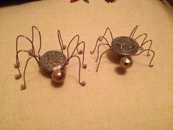 "aJULIESTELLFOX/Sun-Gazette Halloween-inspired wire, button spiders made using a Pinterest ""pin"" are shown above."