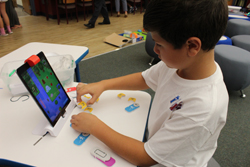 CARA MORNINGSTAR/Sun-Gazette Luke Edmonds, third grader, plays with new technology in the new iPlay lab at Donald E. Schick Elementary in Loyalsock Township during an open house at the school board meeting in September.