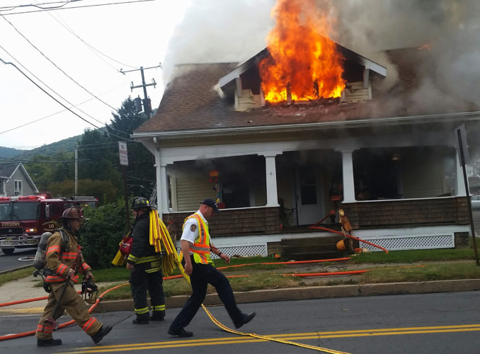PHILIP A. HOLMES/Sun-Gazette This fire at 701 W. Southern Ave. in South Williamsport broke out about noon on Thursday and took about 50 minutes to bring under control.