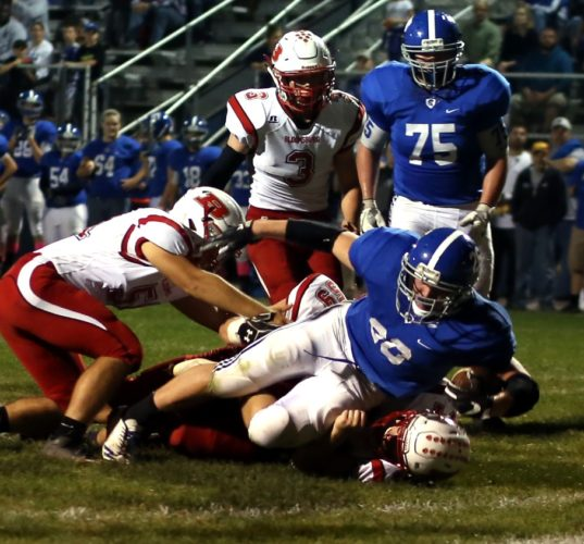 DAVE KENNEDY/Sun-Gazette Correspondent Gideon Green (26) of South Williamsport scores a touchdown Friday night vs. Bloomsburg.