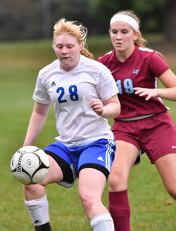 MARK NANCE/Sun-Gazette South Williamsport's Lela Warner, front, plays the ball during a game last week against Loyalsock. Warner leads the Mounties in goals a year after an injury took away her sophomore season.