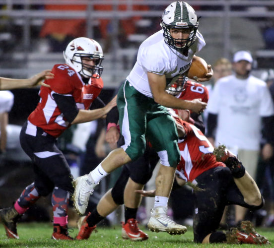 DAVE KENNEDY/For The Sun-Gazette Quinn Henry of Wellsboro breaks a tackle as he runs for a touchdown against Montgomery in the first quarter Friday at Montgomery.