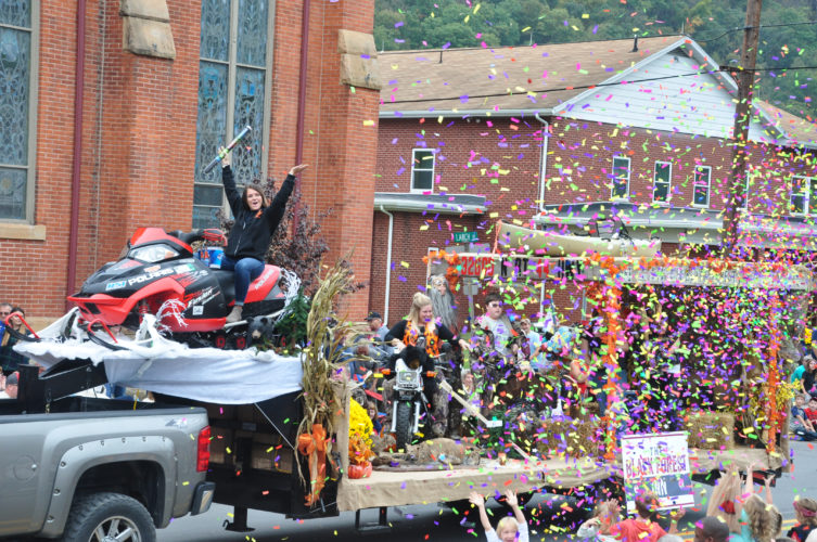 The Black Forest Inn provided a float that includes a snow mobile on top of a truck as the participants fire confetti to the delight of the crowd.