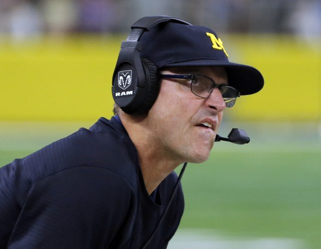 ASSOCIATED PRESS Jim Harbaugh and Michigan visit Happy Valley Saturday coming off an overtime win at Indiana.