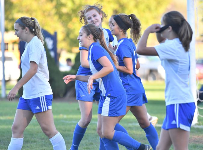 MARK NANCE/Sun-Gazette Madie Majcher, second from right, is congratulated by Abby Staman, middle after scoring the lone goal for Warrior Run Tuesday at South Williamsport.